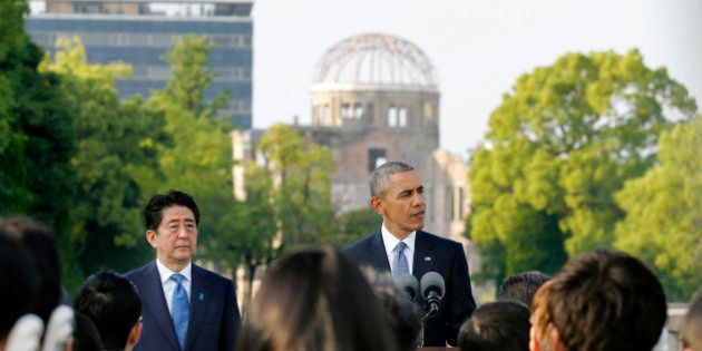 U.S. President Barack Obama gives a speech next to Japanese Prime Minister Shinzo Abe at Hiroshima Peace...