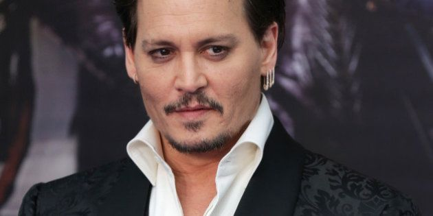 Actor Johnny Depp arrives at the European Premiere of Alice Through the Looking Glass at a cinema in...