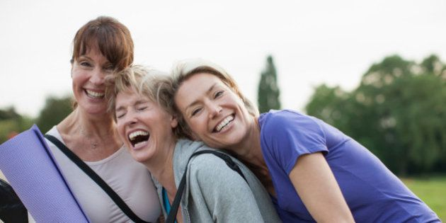 Smiling women holding yoga