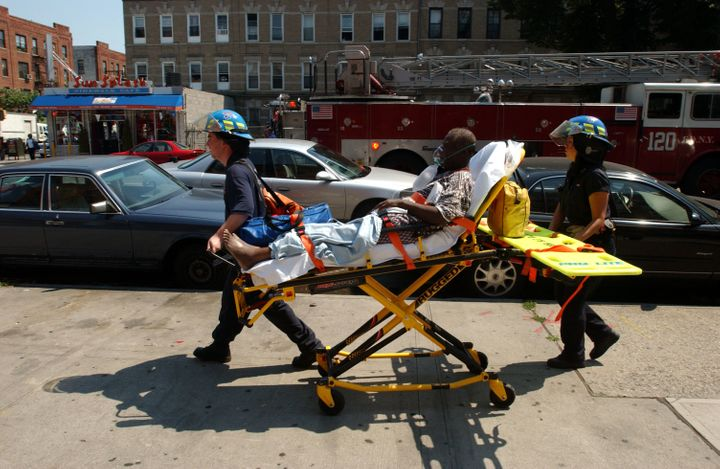 A woman suffering heat-related injuries is taken to the hospital in Brooklyn, New York, in July 2006.
