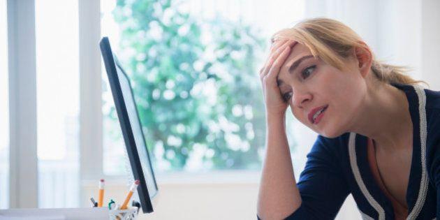Frustrated Caucasian businesswoman using