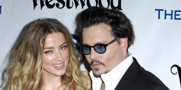 Photo by: Michael Germana/STAR MAX/IPx 1/9/16 Amber Heard and Johnny Depp at The Art of Elysium's Ninth...