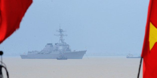 The USS destroyer Lassen is seen anchored along with the 7th Fleet flagship, USS Blue Ridge (unseen)...