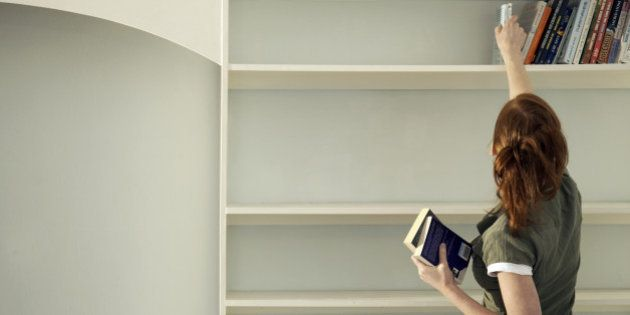 Woman removing books from the