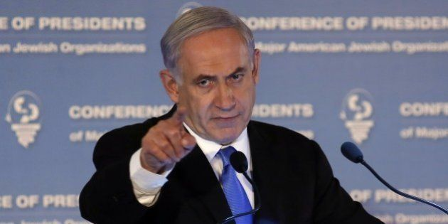 Israeli Prime Minister Benjamin Netanyahu gestures as he delivers a speech during the Presidents Conference...