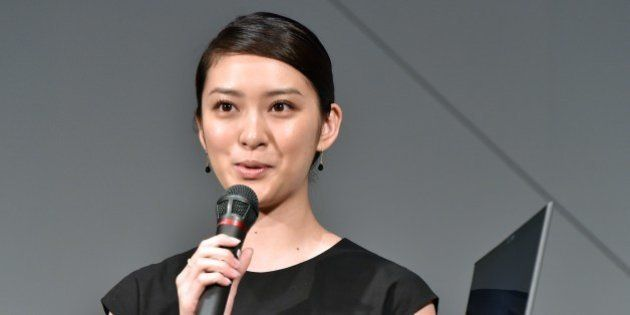 Japanese actress Emi Takei speaks while holding the 'world's lightest notebook computer', with a 13.3-inch...