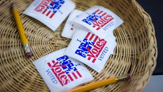 CONCORD, NH - FEBRUARY 9: Stickers are seen as people mark their ballots for the New Hampshire primary in booths at Immaculate Conception Church in Concord, NH on Tuesday Feb. 09, 2016. (Photo by Jabin Botsford/The Washington Post via Getty Images)