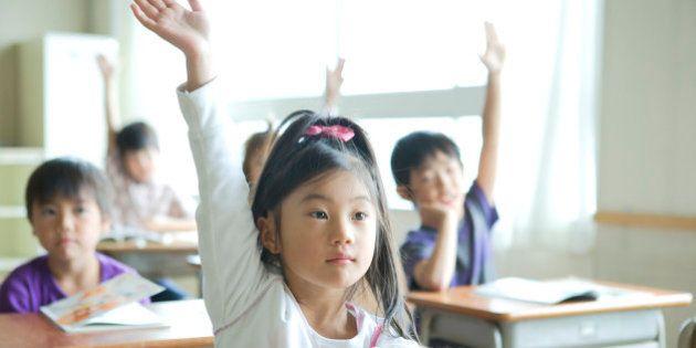 Schoolgirl (8-9) raising her