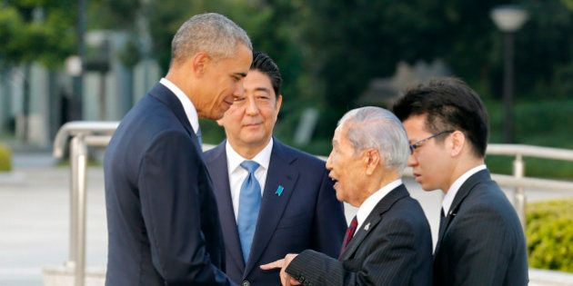U.S. President Barack Obama, left, shakes hands and chats with Sunao Tsuboi, second right, a survivor...
