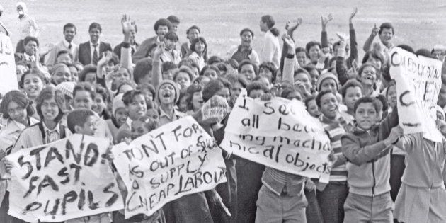 SOUTH AFRICA - 1980's: (SOUTH AFRICA OUT) High school students protesting during the apartheid-era, waving...