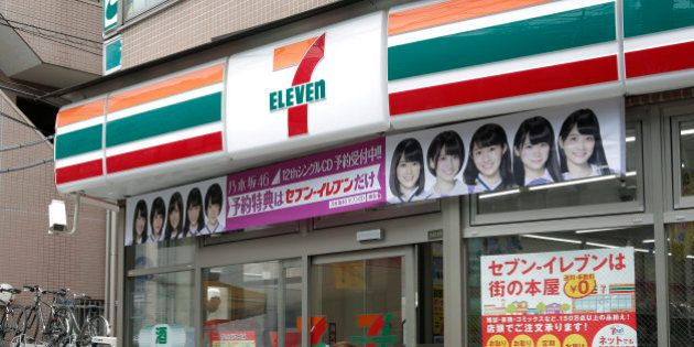 A customer enters a 7-Eleven convenience store, operated by Seven & I Holdings Co., in Tokyo, Japan,...