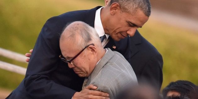 HIROSHIMA, JAPAN - MAY 27: U.S. President Barack Obama embraces an a-bomb victim at the Hiroshima Peace...