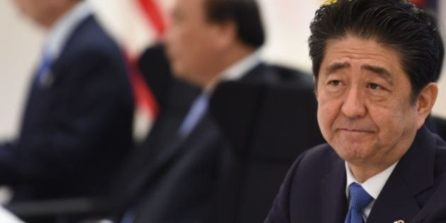 Japan's Prime Minister Shinzo Abe takes part in a dialogue with world leaders at the G7 Summit in Shima...