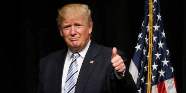 Republican presidential candidate Donald Trump acknowledges the crowd after giving an energy speech at...