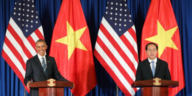 Vietnam's President Tran Dai Quang, right, and US President Barack Obama attend a press conference in...