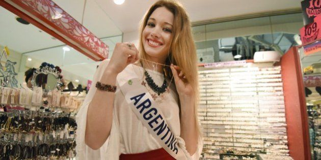 Miss International contestant, Miss Argentine Helena Zuiani visits the Shibuya 109 shopping mall in Tokyo...