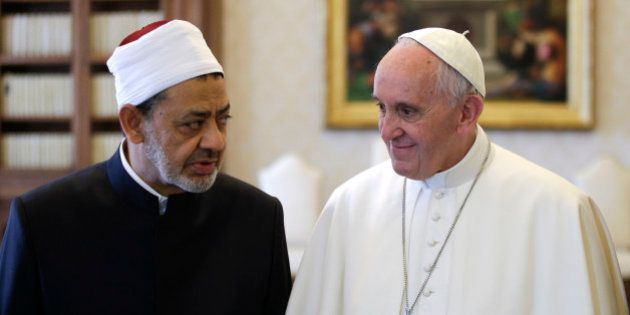 Sheik Ahmed el-Tayyib, Grand Imam of Al-Azhar Mosque, talks with Pope Francis during a private audience...