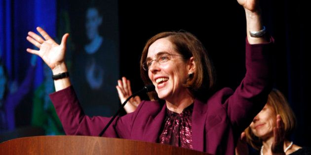 FILE - In this Nov. 6, 2012 file photo, Oregon Democratic Secretary of State Kate Brown celebrates at...