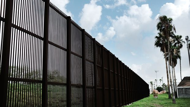 BROWNSVILLE, TX - JUNE 25:  A border fence separates Mexico from the U.S. on June 25, 2018 in Brownsville, Texas. Immigration has once again been put in the spotlight as Democrats and Republicans spar over the detention of children and families seeking asylum at the border. Before President Donald Trump signed an executive order last week that halts the practice of separating families who are seeking asylum, more than 2,300 immigrant children had been separated from their parents in the zero-tolerance policy for border crossers.  (Photo by Spencer Platt/Getty Images)
