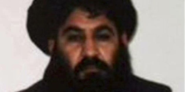 Mullah Akhtar Mohammad Mansour, Taliban militants' new leader, is seen in this undated handout photograph...