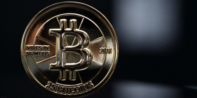 Bloomberg's Best Photos 2013: A twenty-five bitcoin is arranged for a photograph in Tokyo, Japan, on...