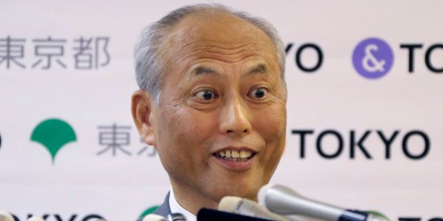 Tokyo Gov. Yoichi Masuzoe answers reporters questions during a press conference in Tokyo, Friday, May...