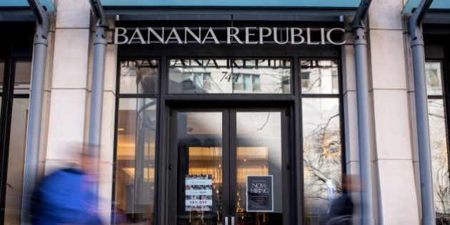 Pedestrians walk past a Banana Republic LLC store in Chicago, Illinois, U.S., on Friday, Feb. 19, 2016....