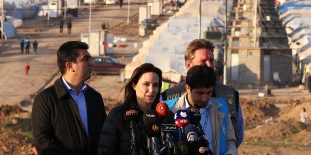 US actress and UNHCR ambassador Angelina Jolie delivers a speech during a visit to a camp for displaced...