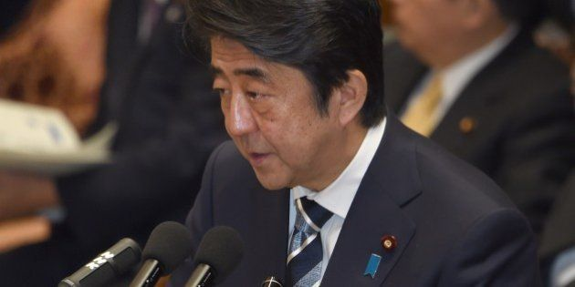 Japanese Prime Minister Shinzo Abe answers questions at parliament in Tokyo on January 29, 2015. Japan...