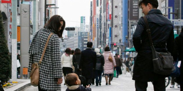 A family walks through the Ginza district of Tokyo, Japan, on Monday, Feb. 15, 2010. Japan's economic...