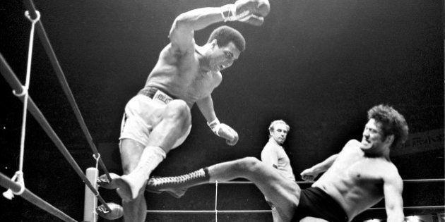 TOKYO, JAPAN: Boxer Muhammad Ali (L) fights with wrestler Antonio Inoki at Nihon Budokan on June 26,...