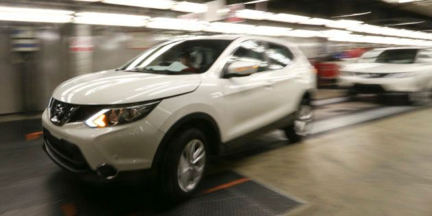 A new Nissan Qashqai SUV automobile is driven off the production line at Nissan Motor Co.'s vehicle assembly...