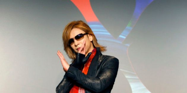Japanese rock band X Japan's drummer Yoshiki poses for photographers during X Japan's promotional event...