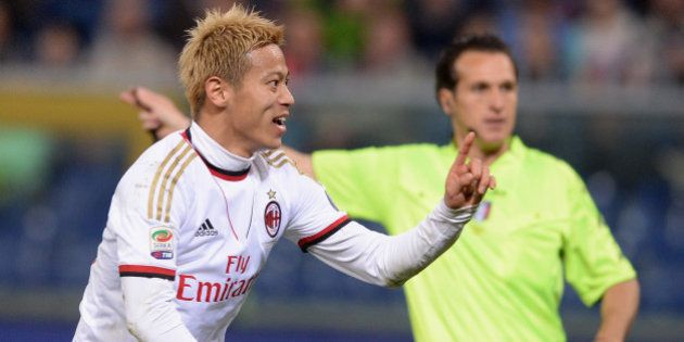 GENOA, ITALY - APRIL 07: Keisuke Honda of AC Milan #10 celebrates scoring the second goal during the...