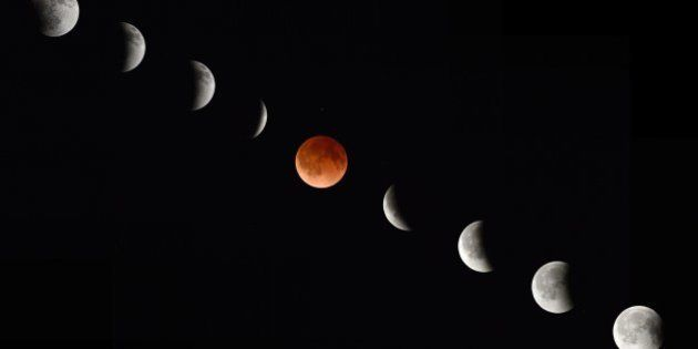 In this composite photograph the moon during various phases at the begining, middle and end of a total...