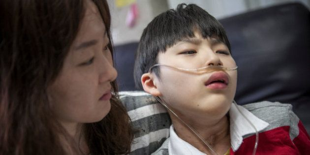 YONGIN, SOUTH KOREA - MAY 06: Kwon Mi-ae, mother of Lim Seong-joon, 13, who is suffering from chronic...