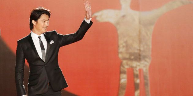 Japanese actor Masaharu Fukuyama waves to fans on the red carpet prior to the opening ceremony of the...