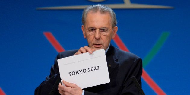 International Olympic Committee (IOC) President Jacques Rogge shows the name of the city of Tokyo elected...