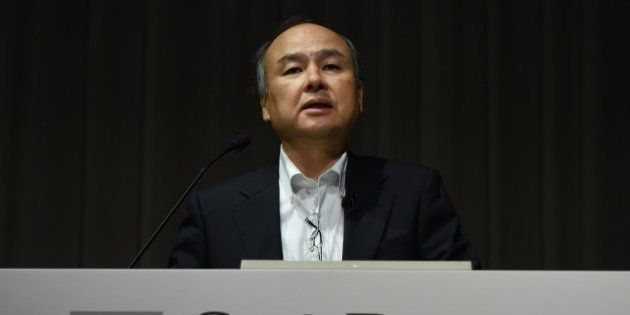 Masayoshi Son, president of Japan's telecom and Internet group SoftBank Group, speaks during a press...
