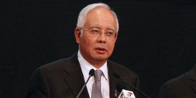 Left to right, Azharuddin Abdul Rahman, director general of Malaysia's Department of Civil Aviation,...