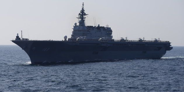 The Izumo military helicopter carrier of the Japan Maritime Self-Defense Force (JMSDF) sails during its...