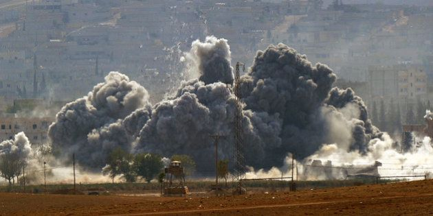 SANLIURFA, TURKEY - OCTOBER 28: (TURKEY OUT) An explosion following an air-strike in the Syrian town...