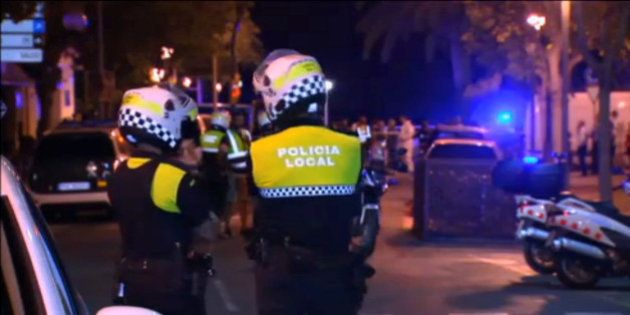 Officers investigate at the scene where police had killed four attackers in Cambrils, south of Barcelona,...