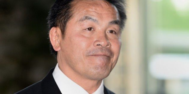 Newly appointed Japanese Education, Culture, Sports and Science Minister Hiroshi Hase enters the prime...