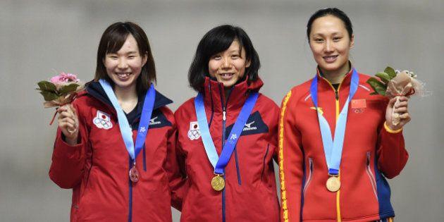 SAPPORO, JAPAN - FEBRUARY 21: (L-R) Misaki Oshigiri of Japan (silver), Miho Takagi of Japan (gold) and...