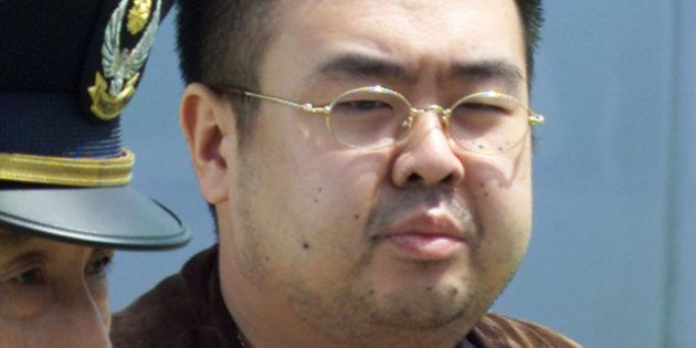 THE MAN BELIEVED TO BE NORTH KOREAN HEIR-APPARENT KIM JONG-NAM IS ESCORTED TO AN AIRPLANE UPON HIS DEPORTATION...