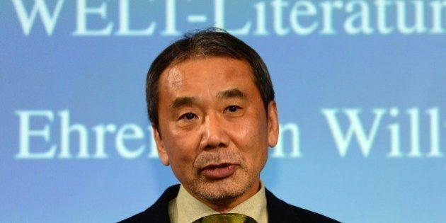 Japanese writer Haruki Murakami poses for photographers prior to an award ceremony for the Germany's...