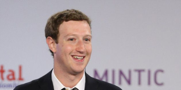 Facebook founder and CEO Mark Zuckerberg smiles during an event to launch in Colombia an app providing...