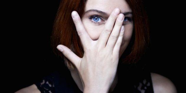 woman hiding behind