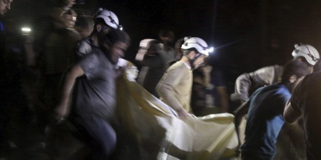 Civil defence members carry a casualty after an airstrike at a field hospital in the rebel held area...